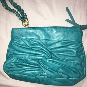 Oversized teal clutch